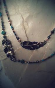 horizontal feathers with beads